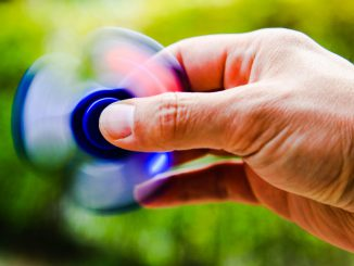 A blue fidget spinner.