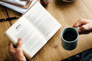 A book being read with coffee.