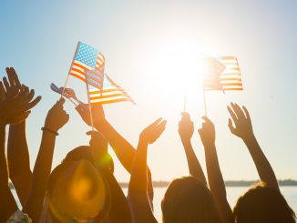 People waiving American flags on Memorial day