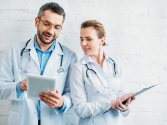 Happy Doctors working on tablets